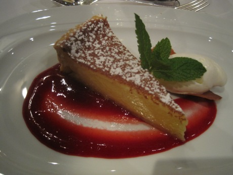 Araxi Lemon Tart  with sweet pastry crust, crème fraiche ice cream, preserved raspberry coulis.
